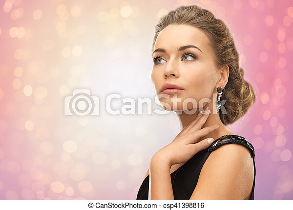 beautiful woman with diamond earrings - csp41398816