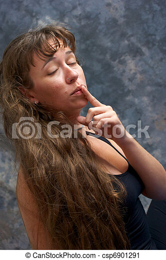 beautiful woman with finger to lips - csp6901291