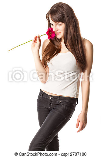 Beautiful woman with flower in a studio - csp12707100
