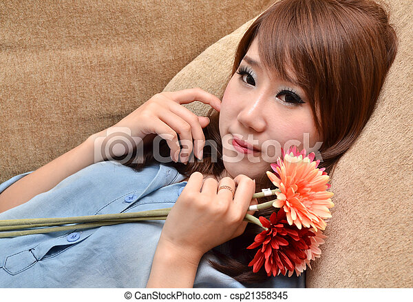 Beautiful woman with flowers - csp21358345