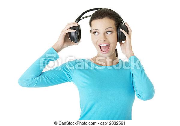 Beautiful woman with headphones - csp12032561