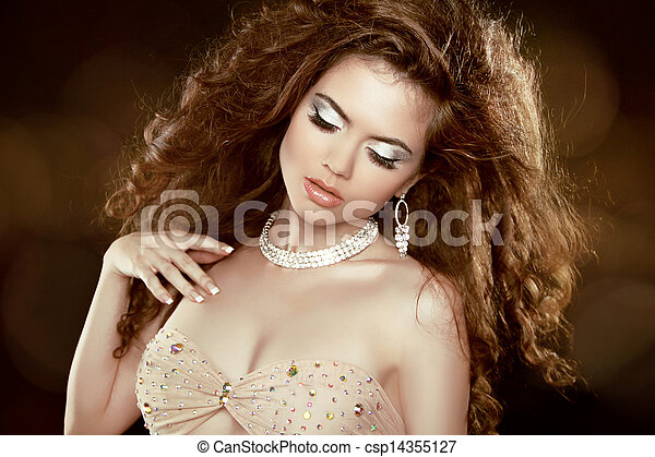 Beautiful woman with long brown curly hair and makeup. Hairstyle. Jewelry and Fashion.  - csp14355127