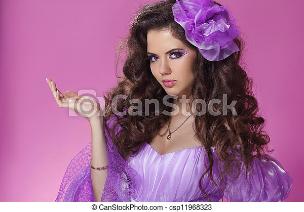 Beautiful woman with long curly hair style over purple - csp11968323