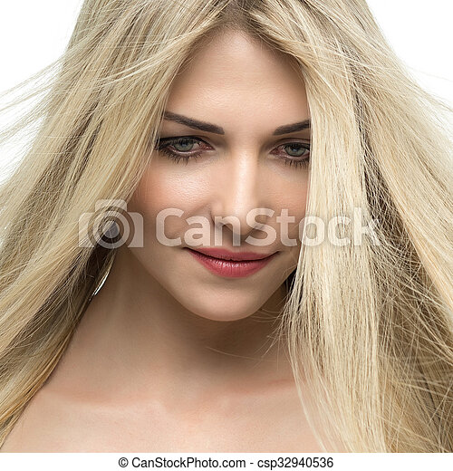 Beautiful woman with long straight blond hair. - csp32940536