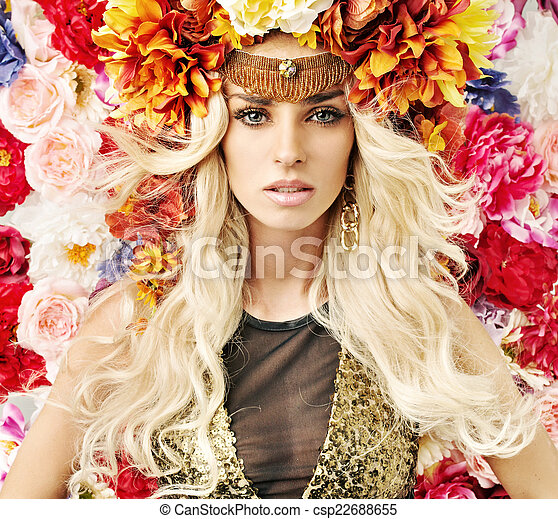 Beautiful woman with lots of colorful flowers - csp22688655