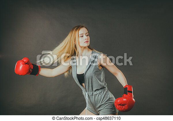 Beautiful woman with red boxing gloves - csp48637110