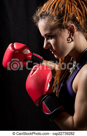 Beautiful woman with red boxing gloves, dreadlocks  - csp22739282