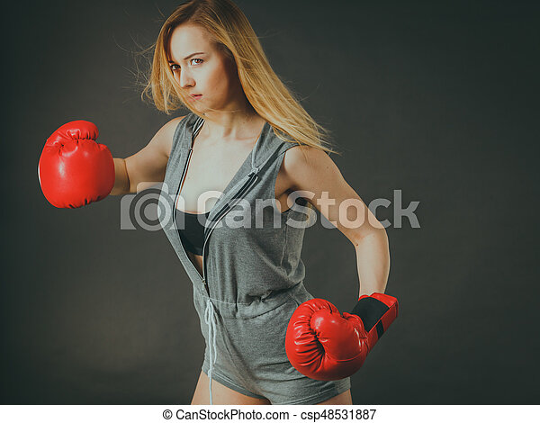 Beautiful woman with red boxing gloves - csp48531887