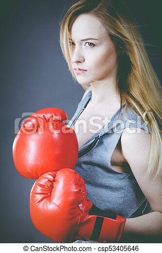Beautiful woman with red boxing gloves - csp53405646