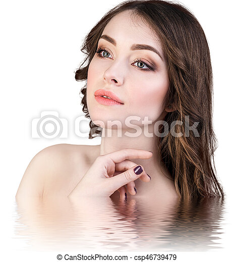 Beautiful woman with reflection on water surface - csp46739479