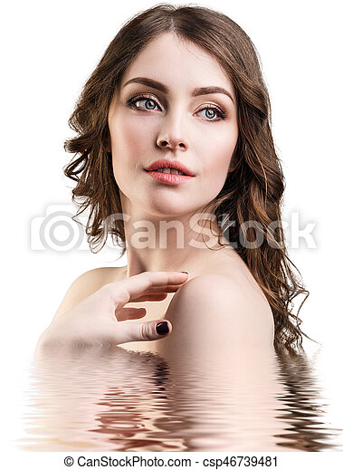 Beautiful woman with reflection on water surface - csp46739481