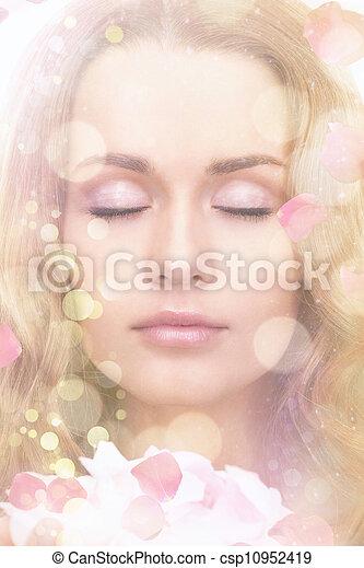 beautiful woman with rose petals - csp10952419