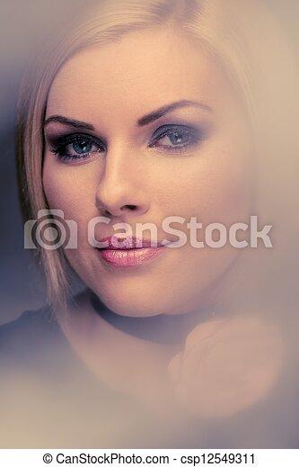 Beautiful woman with rosebud  - csp12549311