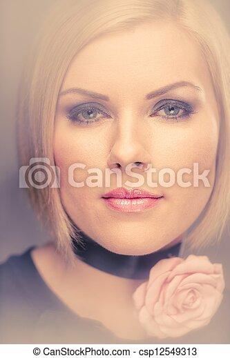 Beautiful woman with rosebud  - csp12549313