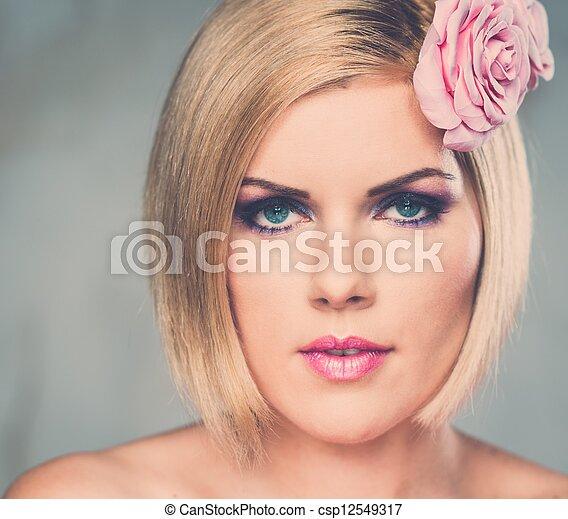 Beautiful woman with rosebud  - csp12549317