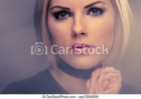 Beautiful woman with rosebud  - csp12549309