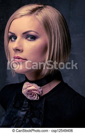 Beautiful woman with rosebud  - csp12549406