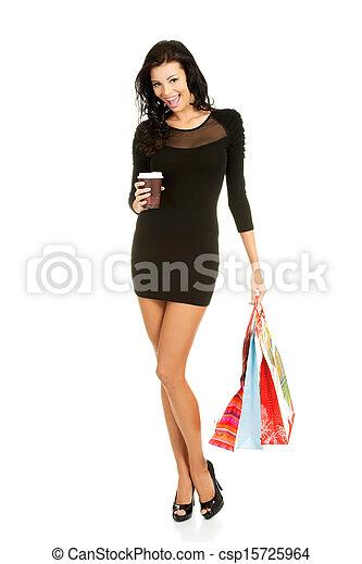 Beautiful woman with shopping bags - csp15725964