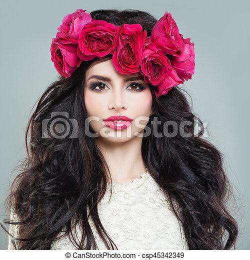 Beautiful Woman with Summer Flowers. Brunette Beauty - csp45342349