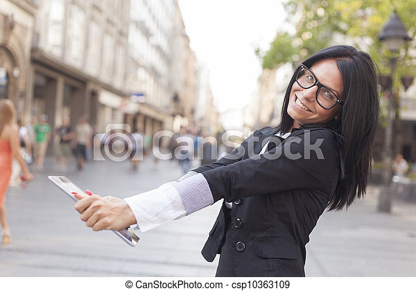 Beautiful Woman With Tablet Computer on street - csp10363109
