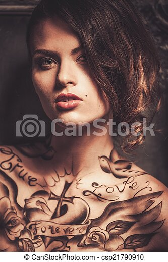 Beautiful woman with tattoos  - csp21790910