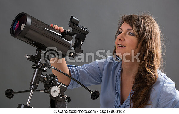 Beautiful woman with telescope - csp17968482