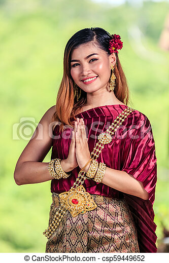 https://comps.canstockphoto.com/beautiful-woman-with-thai-traditional-stock-images_csp59449652.jpg