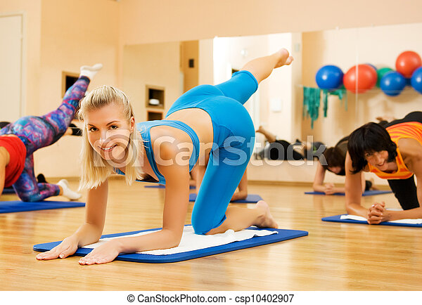 Beautiful women exercising in fitness club - csp10402907