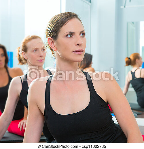 Beautiful women group in a row at aerobics class  - csp11002785