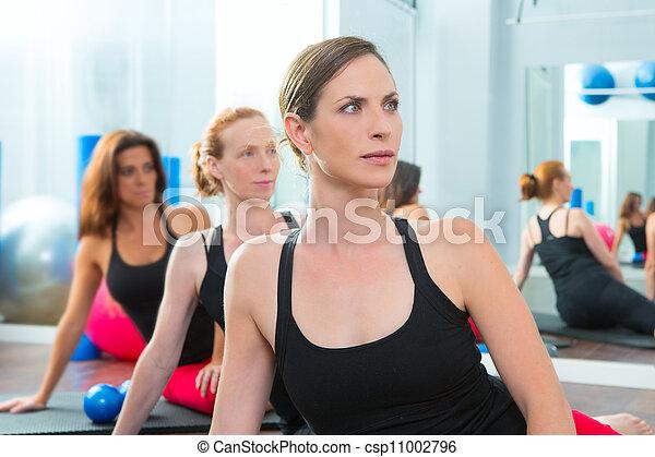 Beautiful women group in a row at aerobics class  - csp11002796