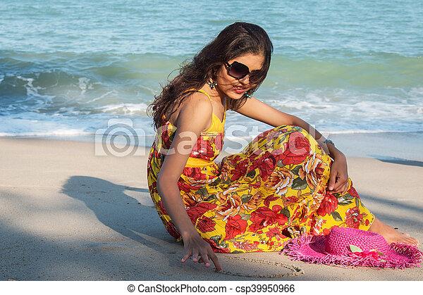 Beautiful women sitting on the beach - csp39950966