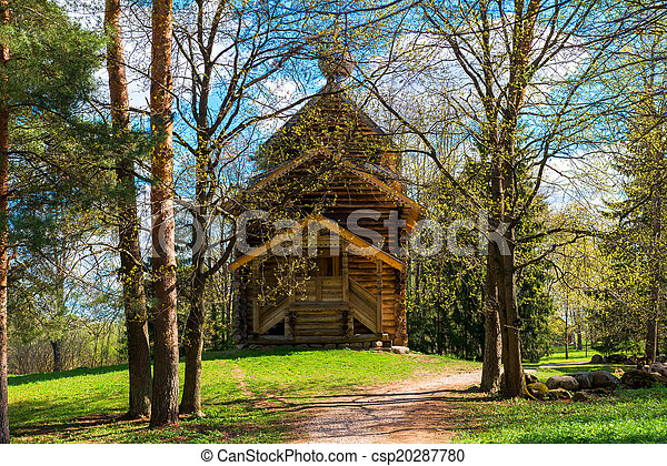 Beautiful wooden church in a forest - csp20287780