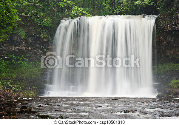 Beautiful woodland stream and waterfall in Summer - csp10501310