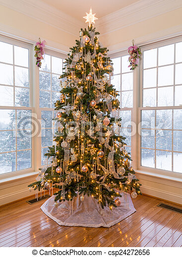 Beautiful xmas tree with snow outside. Christmas tree in modern home ...