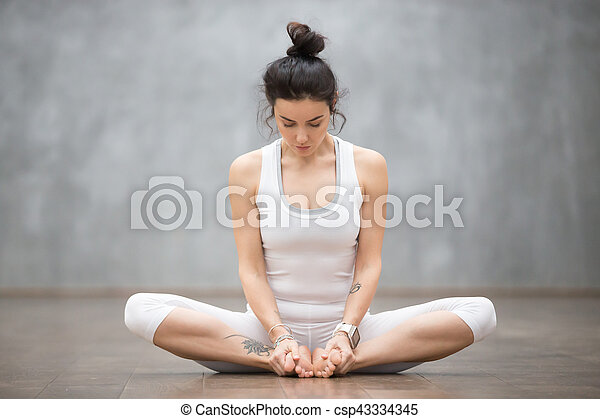Beautiful Yoga Bound Angle Pose Portrait Of Beautiful Young Woman With Floral Tattoos Working Out Against Grey Wall Doing