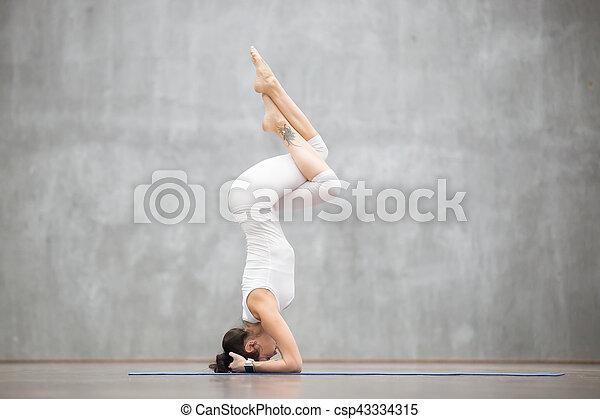 beautiful yoga garuda salamba sirsasana pose portrait of