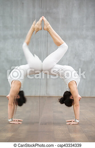 beautiful yoga handstand pose with backbend side view