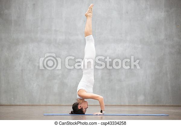 beautiful yoga headstand pose portrait of beautiful