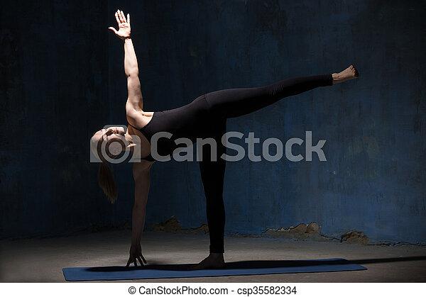 beautiful yoga woman doing half moon pose beautiful