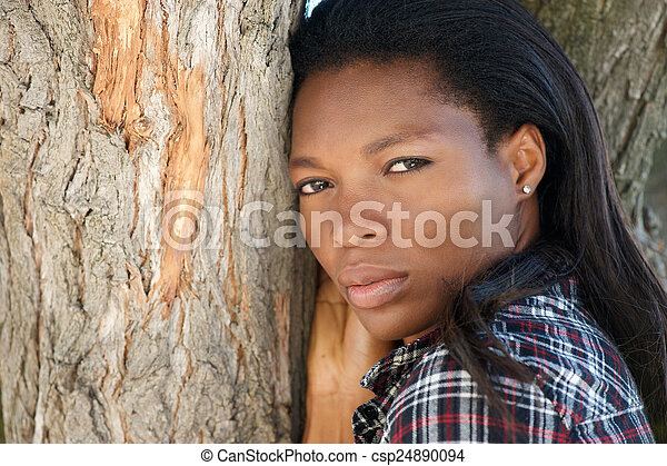 Beautiful young african american woman with long hair - csp24890094