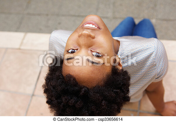 Beautiful young african woman looking up - csp33656614