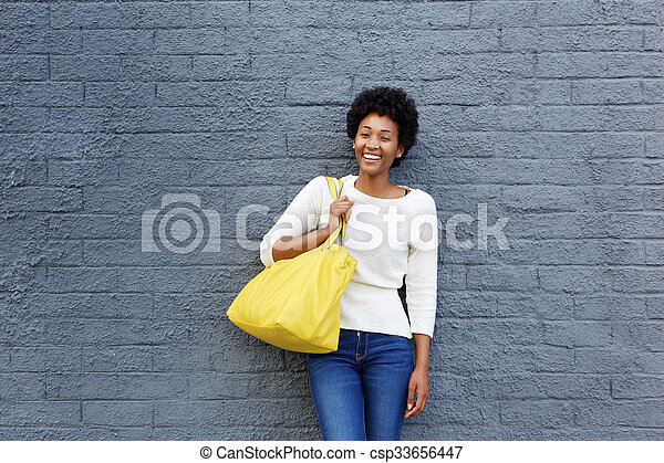 Beautiful young african woman with handbag - csp33656447