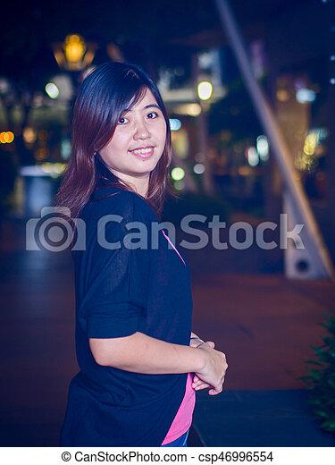 Beautiful Young Asian - Chinese Woman Smiling at Night - csp46996554