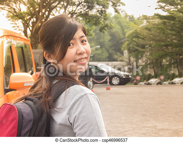 Beautiful Young Asian - Chinese Woman Smiling Going to Travel - csp46996537