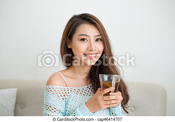 drinking Asian woman