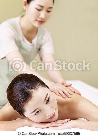 Asian girl on girl massage
