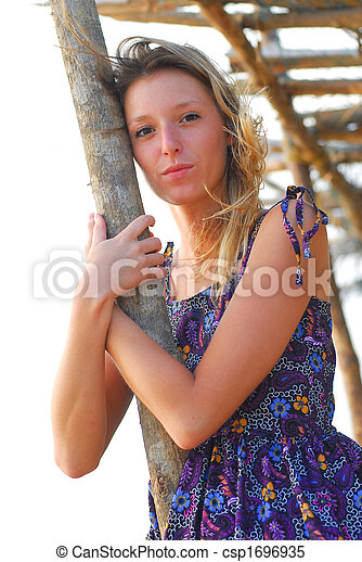 Beautiful young blond girl on beach - csp1696935