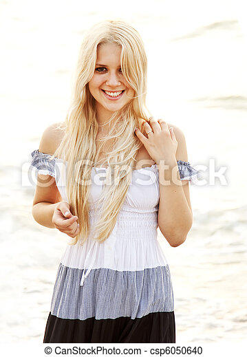 Beautiful young blonde girl on the beach - csp6050640