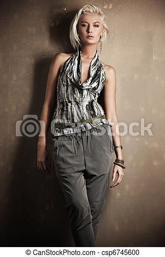 Beautiful young blonde girl posing - csp6745600