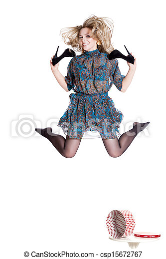 Beautiful young blonde jumping with shoes in hand - csp15672767